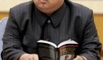 kim jong un leyendo un libro de trump