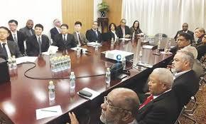 chinos en mesa negociacion rd